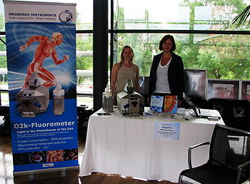 Sandra and Mona at exhibition booth of OROBOROS; ISMM2014 Bolzano